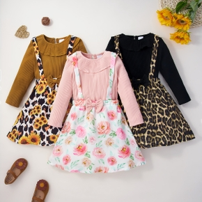 2-piece Toddler Girl Doll Collar Ribbed Solid Long-sleeve Top and Floral/Leopard Print Bowknot Suspender Skirt Set