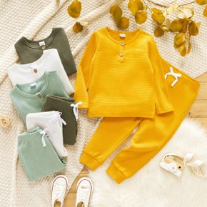 2-piece Toddler Girl Waffle Knit Henley Shirt and Bows Design Solid Pants Set