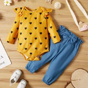 2pcs Baby All Over Love Heart Print Ribbed Ruffle Long-sleeve Romper and Solid Bowknot Trousers Set